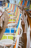 Line of Yellow Orange and Blue Chairs Stock Photography