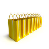 Line of yellow striped shopping bags Stock Photos