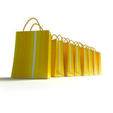 Line of yellow stripped shopping bags. 3D rendering of high quality looking yellow stripped shopping bags against a white background Stock Photo