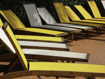 Line of yellow and white sun loungers. Line of empty yellow and white sun loungers Stock Image