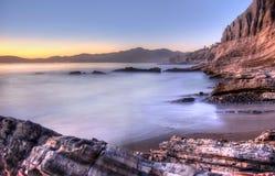 Linea costiera al tramonto Fotografia Stock Libera da Diritti