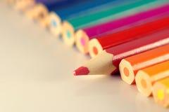Linea di matite con un individuo Fotografia Stock
