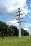 Linea elettrica ad alta tensione puntello grigio del metallo Fotografia Stock