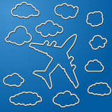Linear airplane with clouds Stock Photography