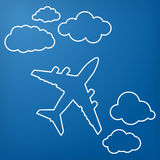 Linear airplane with clouds on a blue air background. Blue sky t. Ravel background Royalty Free Stock Images