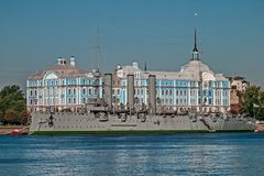 Linear cruiser Aurora, the symbol of the Great October Socialist Revolution. Battleship-museum Cruiser Aurora. On the background of the Nakhimov Naval School royalty free stock photography