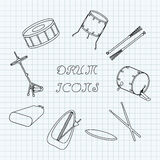 Linear drum icons on the notebook sheet in a cage. Doodle. Vector Royalty Free Stock Photo