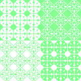 Linear Indian Lotus Pattern. Set of 4 green and white patterns. Seamless repeat backgrounds with stylized linear lotus flowers in groups of four. Vector seamless Royalty Free Stock Photography