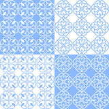 Linear Indian Lotus Pattern. Set of 4 light blue and white patterns. Seamless repeat backgrounds with stylized linear lotus flowers in groups of four. Vector Royalty Free Stock Image