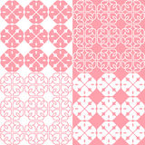 Linear Indian Lotus Pattern. Set of 4 pink and white patterns. Seamless repeat backgrounds with stylized linear lotus flowers in groups of four. Vector seamless Royalty Free Stock Image