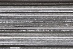 Linear texture of gray asbestos slate plates stacked on top of each other close-up side view Stock Photos