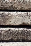 Linear texture of gray concrete plates with a crack stacked on top of each other close-up side view. Conceptual or metaphor wall stock photos