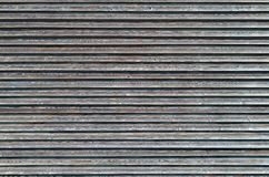 Linear texture of grey surface. With many parallel horizontal lines. Full frame background concept with copy space Royalty Free Stock Photo