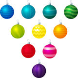 Lined Baubles. A vector illustration of different coloured line patterned Christmas baubles on a white background royalty free illustration