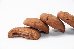Lined chocolate biscuits on a white background Stock Image
