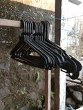 lined clothes hangers are lined up royalty free stock photo