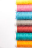 Lined colorful thread for sewing on a white background Royalty Free Stock Photography