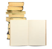 Lined exercise book with books in background Royalty Free Stock Photography