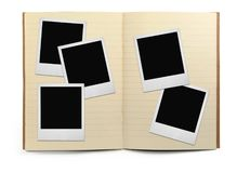 Lined exercise book and photo frames. Visible natural shadow in front Stock Image