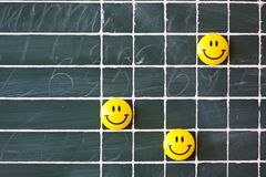School board with magnetic smile. Lined green school board with magnetic smile Stock Photography