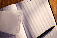 Lined Notebook with Pen on Desk Stock Image