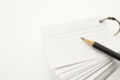Lined notebook and pencil. On white background Royalty Free Stock Photography