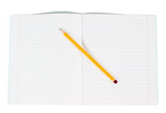 Lined notebook and pencil Stock Images