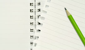 Lined notebook ,tornrd out page, green pencil Royalty Free Stock Photography