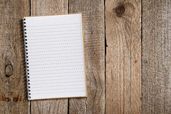 Lined notepad on old wood Royalty Free Stock Images