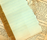 Lined paper on an antique book. Green lined paper on an antique book Stock Photo
