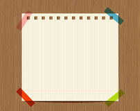 Lined paper of notebook on wooden wall Stock Images