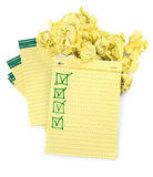 Lined paper notebooks with completed checklist. And crumpled paper Royalty Free Stock Photography