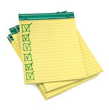 Lined paper notebooks with completed checklist. On white background Stock Photography