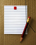 Lined paper and pencil  Stock Images
