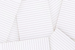 Lined paper strewn over surface Royalty Free Stock Photos