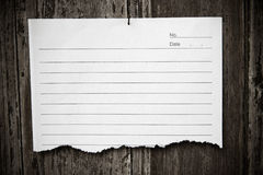 Lined paper textured on wood background Royalty Free Stock Images