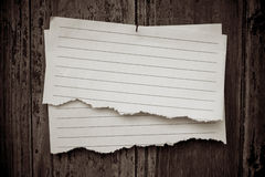 Lined paper textured on wood background Stock Photos