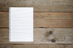 Lined paper on wood Stock Photo