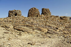 Lined up dramatically atop a rocky ridge, the Beehive Tombs. Of Bat, in Oman, are 4000-5000 years old and a Unesco World Heritage Site royalty free stock photography