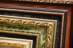 Lined up old wooden vintage art frames. Close-up fragment. For promotional image stock image