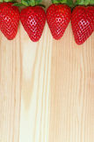 Lined up Vibrant Red Color Fresh Ripe Strawberry Fruits Isolated on Wooden Table, Vertical Photo with Free Space for Text Stock Images