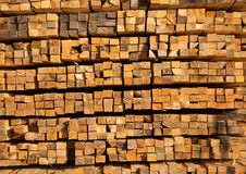 Lined wooden planks. Wooden beams are arranged in a warehouse for sale Royalty Free Stock Image