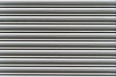 Linee orizzontali grige d'argento del metallo di lerciume - struttura/fondo di alta qualità fotografie stock libere da diritti
