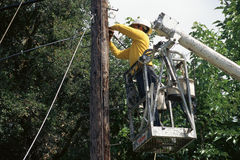 Lineman. Working on a  cable Stock Photos