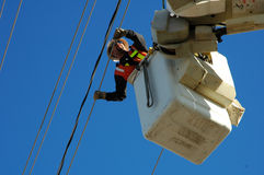 Lineman. Installing power lines Royalty Free Stock Image