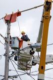 Lineman Repairs Electricity Distribution Lines From An Elevated Royalty Free Stock Photography