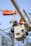 Lineman Repairs Electricity Distribution Lines From An Elevated Royalty Free Stock Images