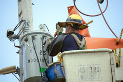 Lineman Repairs Electricity Distribution Lines From An Elevated Royalty Free Stock Photos