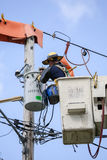 Lineman Repairs Electricity Distribution Lines From An Elevated Royalty Free Stock Photo