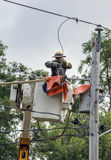 Lineman Repairs Electricity Distribution Lines Royalty Free Stock Photo